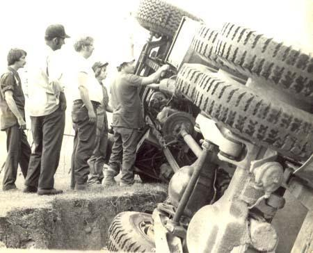 The old crew at Buckhorn examines a rolled over truck.